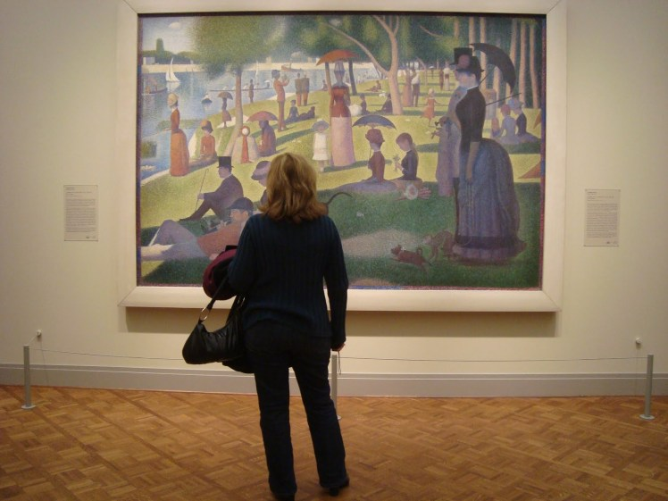 solo travel woman looking at painting Le Grande Jette
