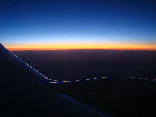 sunset over the wing of an airplane