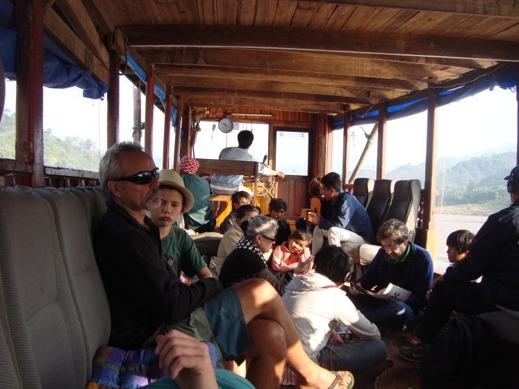 Tourists from Australia and France enjoy the leisurely ride down the Mekong River on the showboat to Luang, Prabang, Laos.