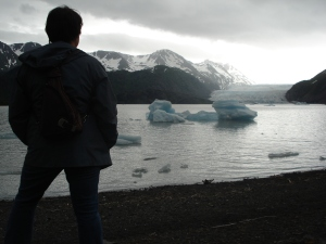 Writer, traveler and blogger Charish Badzinski at glacier near Homer, Alaska.