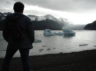 Writer, traveler and blogger Charish Badzinski at glacier near Homer, Alaska.