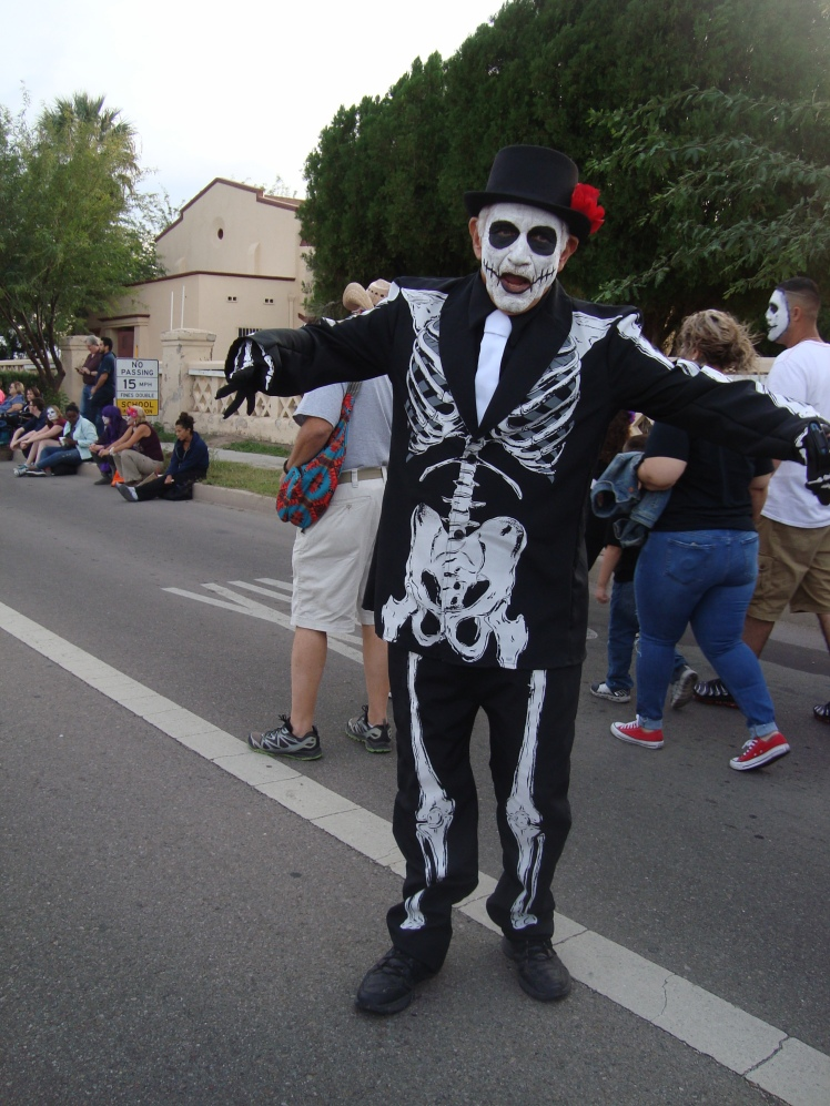 Skeleton costumed man