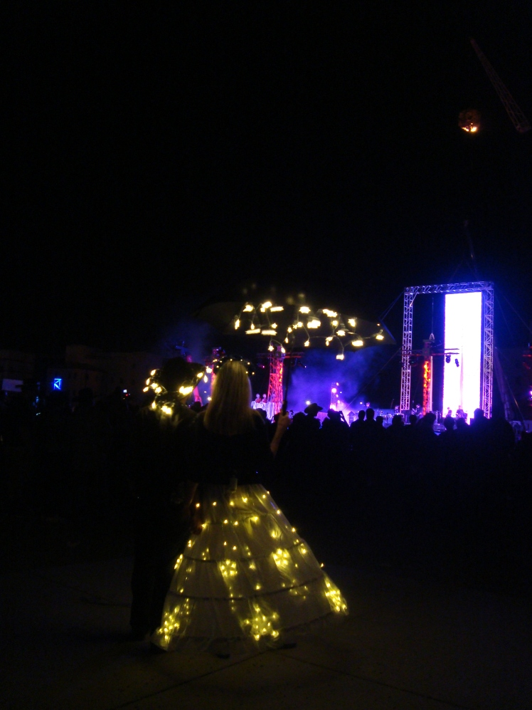Participants in lighted costumes