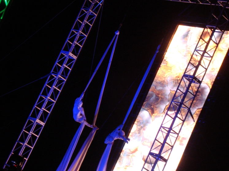 acrobats hanging from scarves