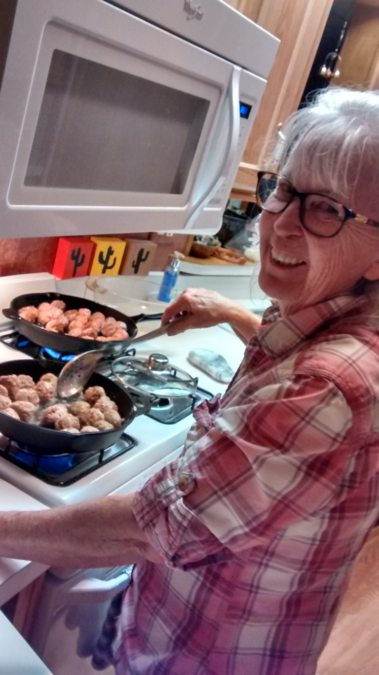 swedish meatballs cooking on stove