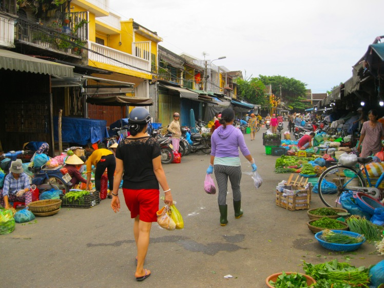 Women shopping for the day's fresh goods at the Central Market in Hoi An, Vietnam. Photo by Charish Badzinski.