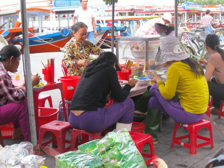 Locals enjoy their breakfast at the Central Market in Hoi An. Photo by Charish Badzinski.