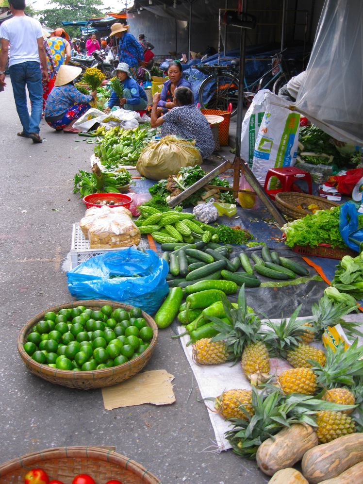 Produce vendors at the Central Market in Hoi An, Vietnam. Photo by Charish Badzinski.