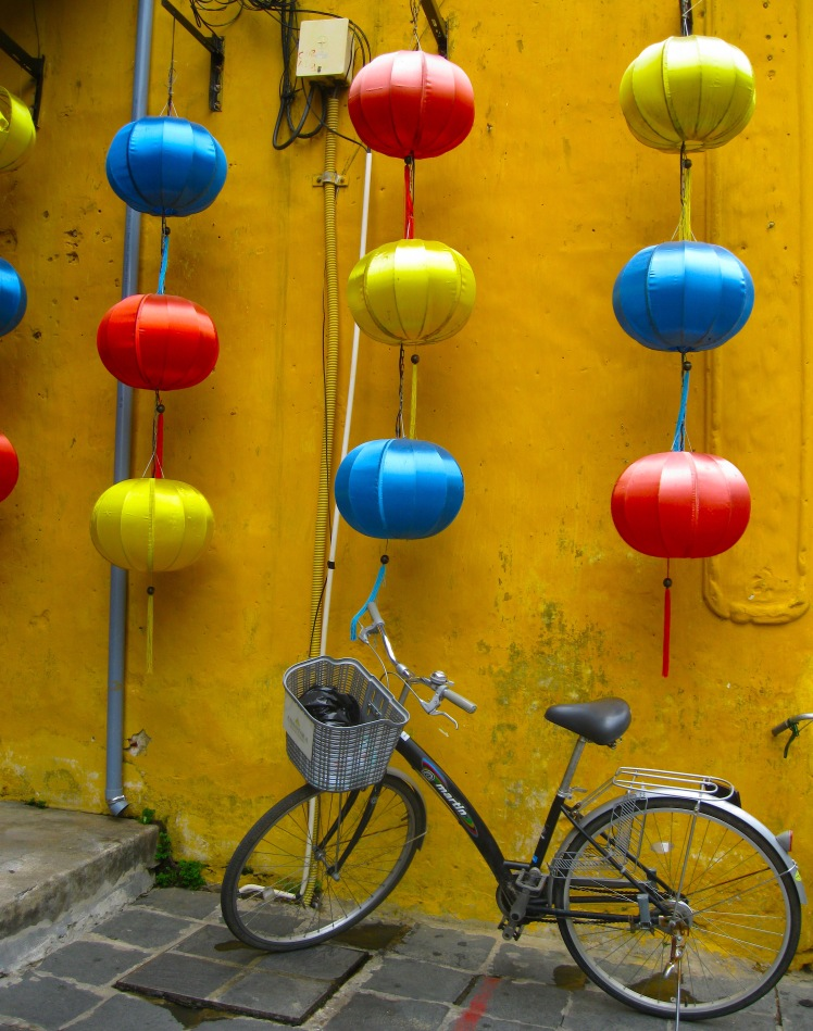 Lanterns and a bicycle in Hoi An. Photo by Charish Badzinski.