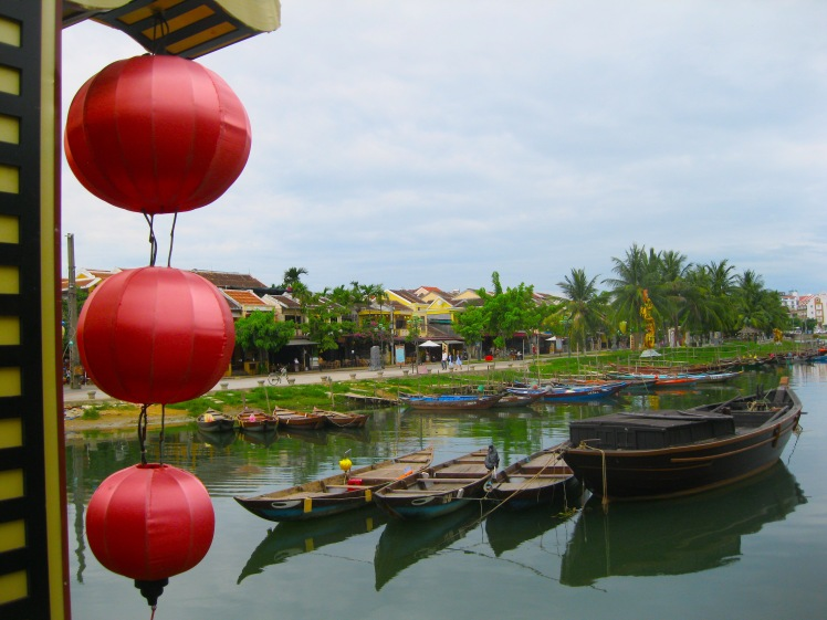 Boats and lanterns at the canal by the old town section of Hoi An. Photo by Charish Badzinski.