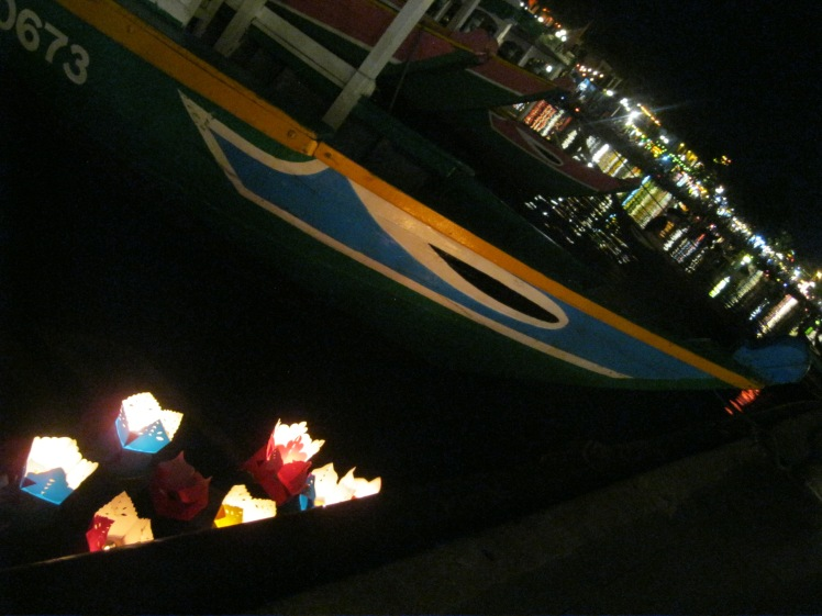 Lanterns holding candles are purchased by tourists and sent out into the canals. Photo by Charish Badzinski.