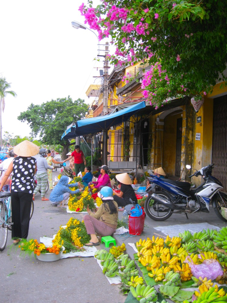 Fruit and flower vendors at the central market in Hoi An