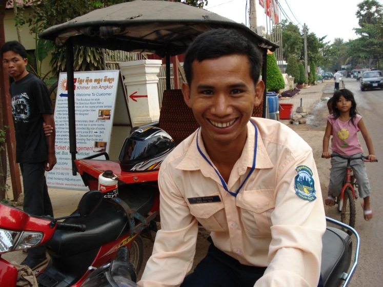 Tuk-tuk driver in Cambodia - budget travel by asking about pricing first