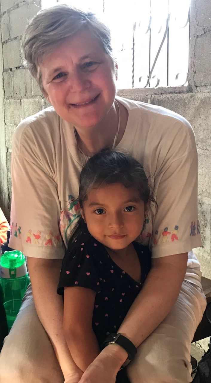 Sister Kathleen Mitchell, FSPA, with a little girl in Honduras