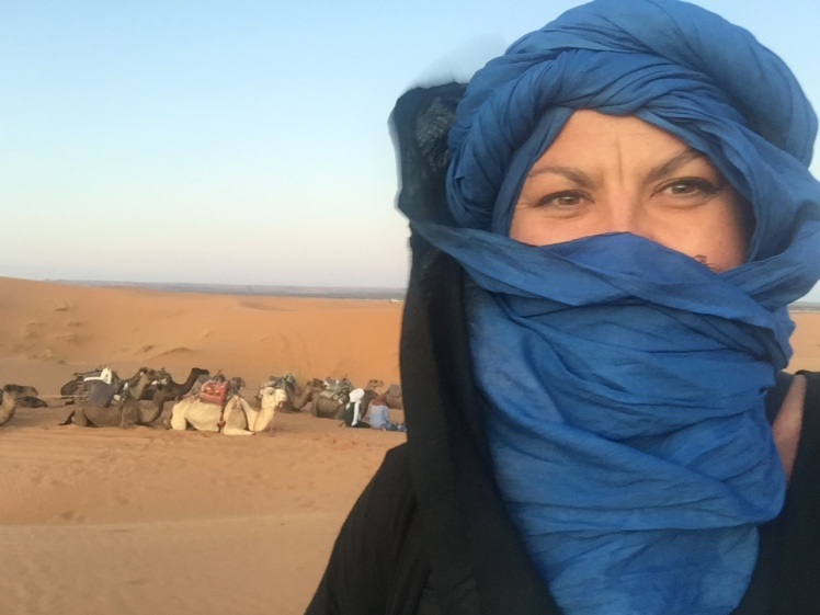Charish Badzinski and camels in the Sahara, a transformational travel moment